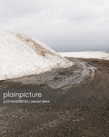 Snowdrift at the edge of the road - p1214m2258724 by Janusz Beck