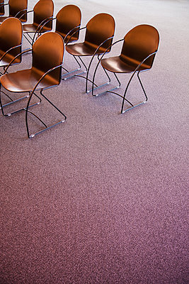 Folding chairs lined up for a business meeting - p1100m1554065 by Mint Images