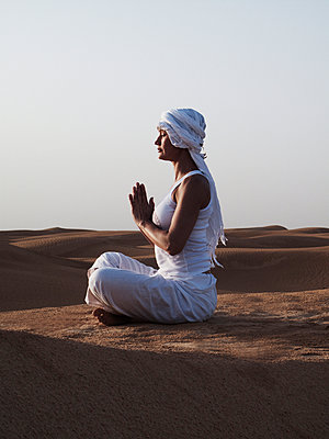 Woman performing yoga in the desert, Tunisia. - p312m1077235f by Lena Koller