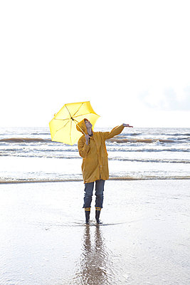 Woman feeling the rain - p4540909 by Lubitz + Dorner