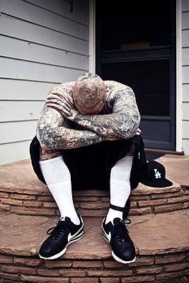 Man with a tattooed skin - p930m814898 by Ignatio Bravo