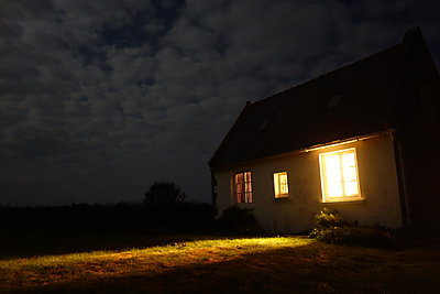 Lighted house in the countryside at night - p1189m1218662 by Adnan Arnaout