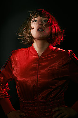 Woman with brown hair wearing a red jacket  - p1540m2128444 by Marie Tercafs