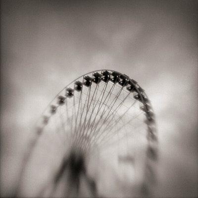Distressed view of ferris wheel - p3721755 by James Godman