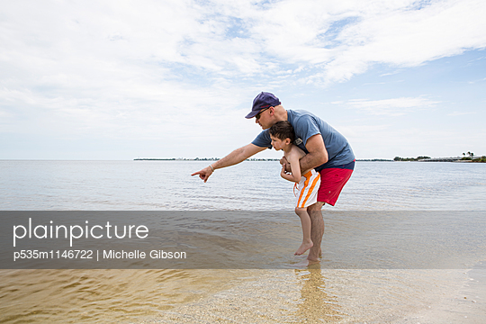 Father and Son - p535m1146722 by Michelle Gibson