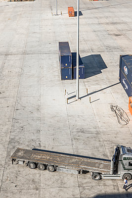 Truck in container port - p1157m1041477 by Klaus Nather