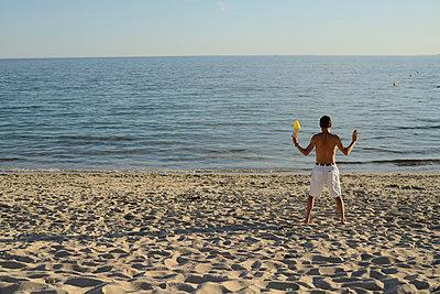 Man practising Qi gong - p1631m2208754 by Raphaël Lorand