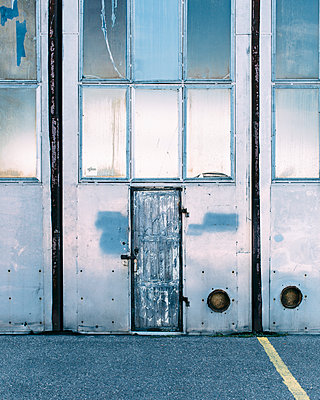 Neglected Hangar Entrance - p1085m1111535 by David Carreno Hansen
