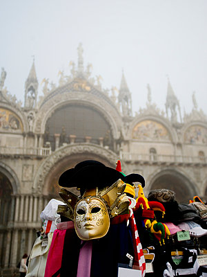 Piazza San Marco and the Basilica San Marco. A stall selling carnival masks and hats.  - p1100m991385f by Mint Images