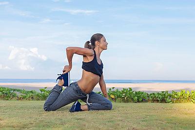 Indonesia, Bali, woman stretching - p300m1568154 by Konstantin Trubavin