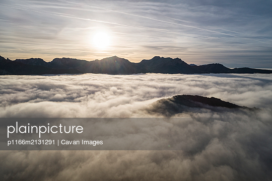 Mists at sunrise from the top of some mountains - p1166m2131291 by Cavan Images