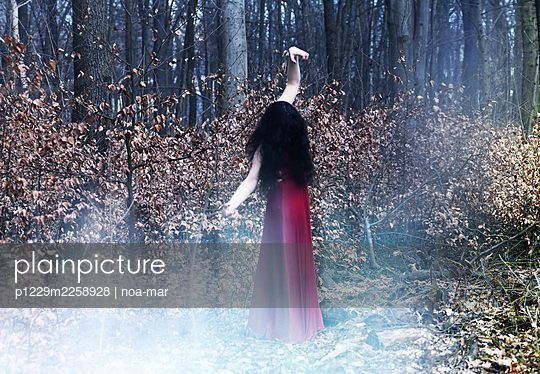 Woman in red dress in the forest - p1229m2258928 by noa-mar