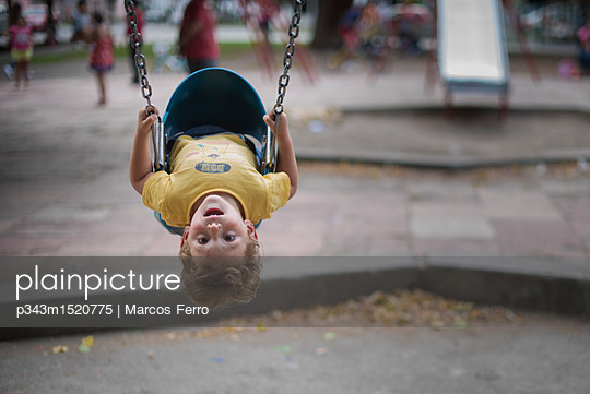 Toddler sitting in swing, Esquel, Chubut Province, Argentina - p343m1520775 by Marcos Ferro