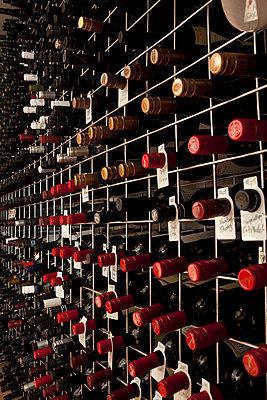 Bottles of wine in a cellar - p30119110f by Caspar Benson