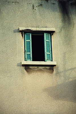 Details of an old building with broken window  - p794m1511070 by Mohamad Itani