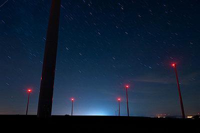 Wind farm at night - p1079m881295 by Ulrich Mertens