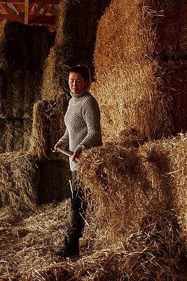Woman working in barn - p312m2139236 by Lisa …berg