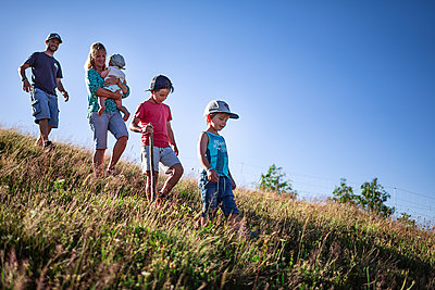Family goes on a hike in the mountains, France - p1007m2219950 by Tilby Vattard
