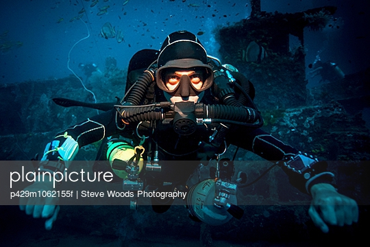 Underwater portrait of technical diver using a rebreather device to locate shipwreck, Lombok, Indonesia - p429m1062155f by Steve Woods Photography