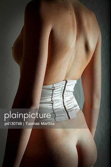 Woman wearing a corset - p4130748 by Tuomas Marttila