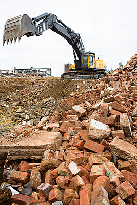 Digger and building rubble - p1057m1045139 by Stephen Shepherd