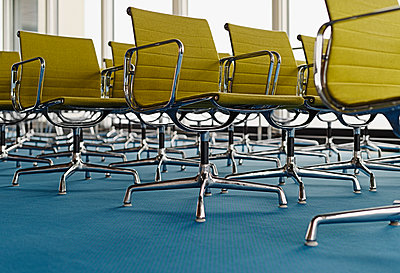 Rows of chairs in green shades - p1292m1134697 by Niels Schubert