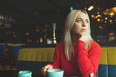 Woman looking away in cafeteria - p1315m2056347 by Wavebreak