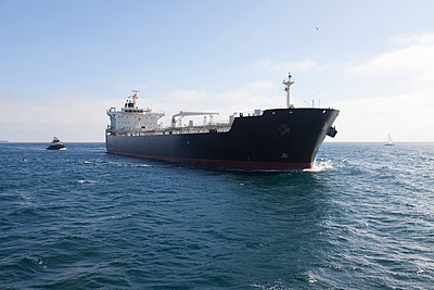 Oil tanker with tugboat at sea - p555m1420392 by Tom Paiva Photography