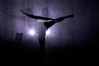 Silhouette of dancer behind transparent curtain - p1411m2128327 by Florent Drillon