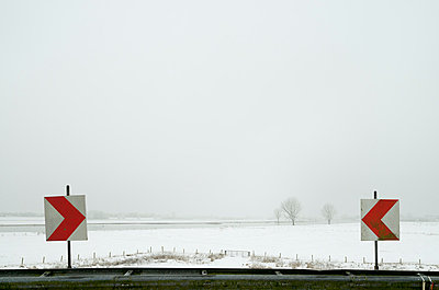 Road signs in snowy rural landscape - p429m817459 by Mischa Keijser