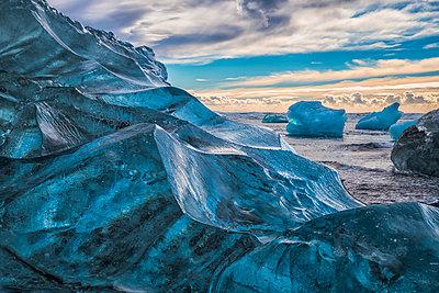 Jokulsarlon or Diamond Beach, with large chunks of ice littering the beach between each high tide; Iceland - p442m2004278 by Robert Postma