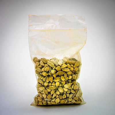 Fennel seeds in a plastic bag. - p813m1122820 by B.Jaubert