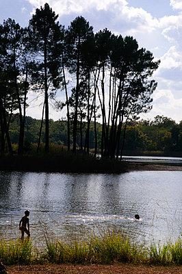 Boy swimming in Lake Jemage - p1072m2157565 by Neville Mountford-Hoare