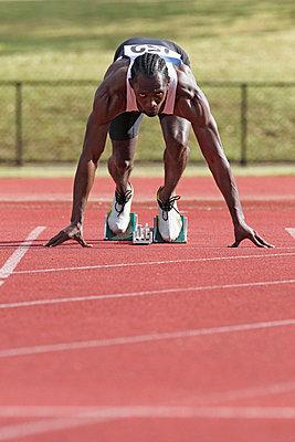 Runner Preparing To Leave Starting Blocks   - p3071303f by Koji Aoki