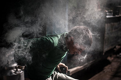 Head of a boy in smoke - p1007m1144334 by Tilby Vattard