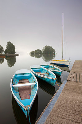 Pleasure boats moored at Llangorse Lake on a misty morning, Brecon Beacons National Park, Powys, Wales, United Kingdom, Europe - p8713059 by Adam Burton