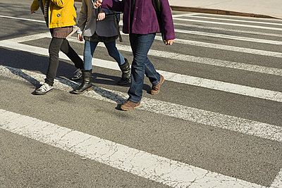 Children walking across road - p9243592f by Image Source