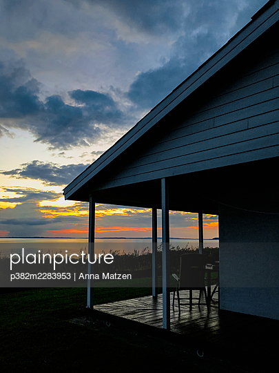 House by the sea at sunset - p382m2283953 by Anna Matzen