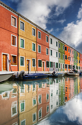 Reflections of Building on Canal Boat in Venice - p1100m2205917 by Mint Images