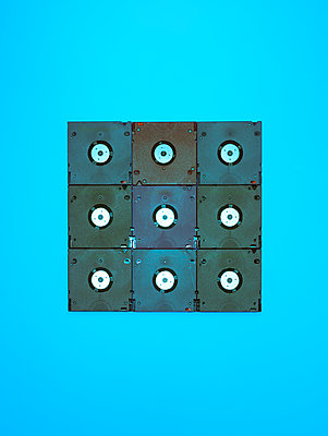 Floppy disks against blue background - p1318m2031948 by Tom Seelbach