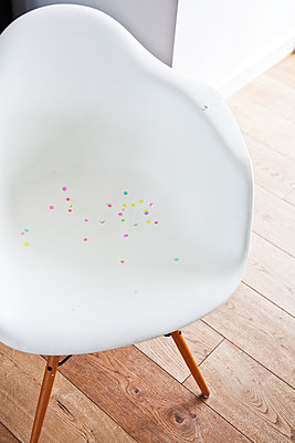 Confetti on white chair - p699m2007788 by Sonja Speck