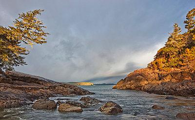 Dawn Breaking Over Rocky Beach; Tofino Vancouver Island British Columbia Canada - p442m839488 by Robert Postma