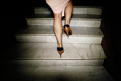 Woman on stairs - p1150m939337 by Elise Ortiou Campion