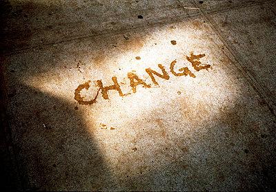 'Change' written on pavement - p388m701461 by Jim Green