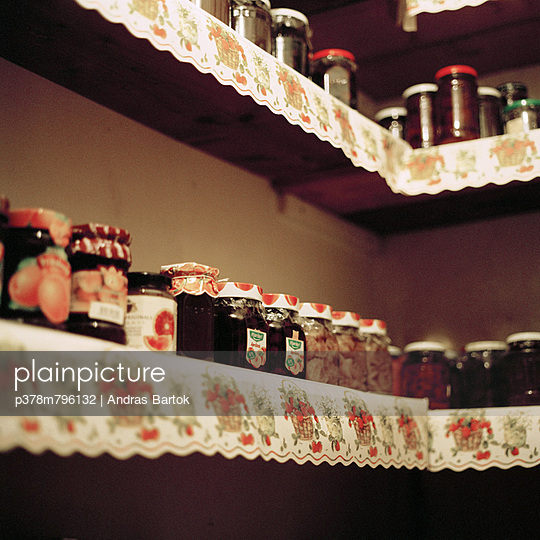 Jam jars on shelf - p378m796132 by Andras Bartok