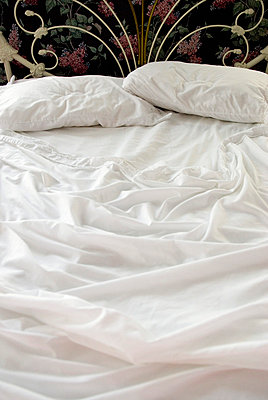 Unmade Bed with White Sheets - p5690157 by Jeff Spielman