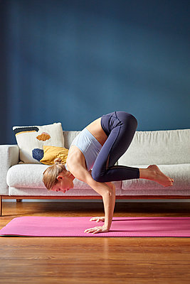 Young woman practicing yoga - p1124m1589403 by Willing-Holtz