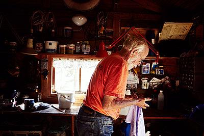 Senior man in workshop - p312m992904f by Johanna Nyholm