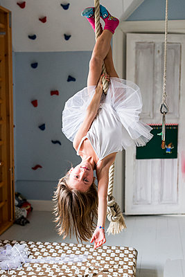 Girl hanging upside down - p312m1407618 by Fredrik Schlyter