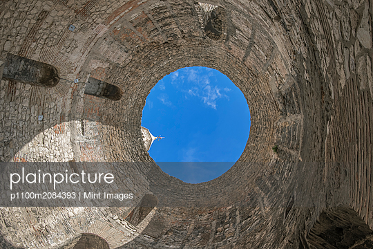 Low angle view of skylight in stone dome,Split, Split, Croatia - p1100m2084393 by Mint Images